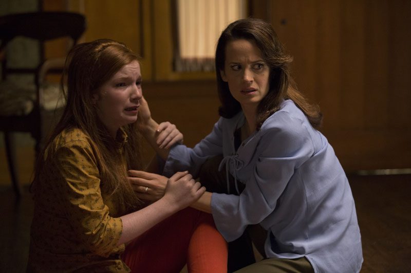 "(L to R) ANNALISE BASSO as Lina and ELIZABETH REASER as Alice, her mother, in ""Ouija: Origin of Evil.""  Inviting audiences again into the lore of the spirit board, the supernatural thriller tells a terrifying new tale as the follow-up to 2014's sleeper hit that opened at No. 1.  In 1965 Los Angeles, a widowed mother and her two daughters add a new stunt to bolster their séance scam business and unwittingly invite authentic evil into their home.  When the youngest daughter is overtaken by the merciless spirit, this small family confronts unthinkable fears to save her and send her possessor back to the other side."